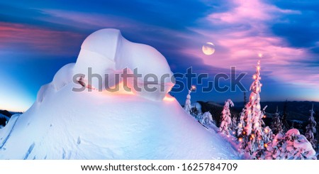 snow cornice at the top is a snow formation formed in the mountains under the influence of wind. Artistic illumination has created a fabulous fiction picture