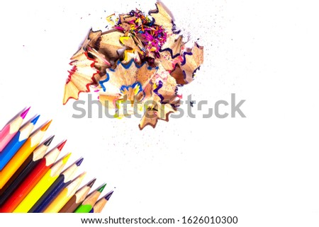 Multi-colored, bright sharpened pencils in different positions on a white background. Pencil sharpener. Pencil shavings. #1626010300