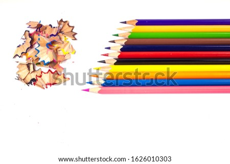 Multi-colored, bright sharpened pencils in different positions on a white background. Pencil sharpener. Pencil shavings. #1626010303