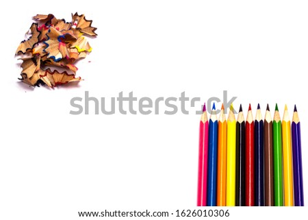 Multi-colored, bright sharpened pencils in different positions on a white background. Pencil sharpener. Pencil shavings. #1626010306