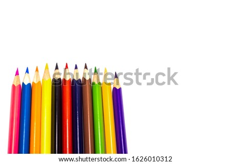 Multi-colored, bright sharpened pencils in different positions on a white background. Pencil sharpener. Pencil shavings. #1626010312