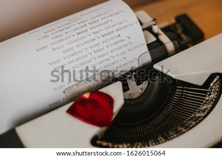 Happy Valentine's Day letter. The letter in typewriter machine, with hearts around.  #1626015064