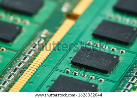 Electronic microcircuit with microchips and capacitors taken closeup Royalty-Free Stock Photo #1626032044