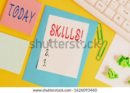 Handwriting text Skills. Concept meaning ability do something very well by nature Flat lay above empty copy space white paper with paper clips on the table. #1626093460