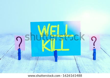 Word writing text Well Kill. Business concept for operation of placing a column of heavy fluid into a well bore Scribbled and crumbling sheet with paper clips placed on the wooden table. #1626161488