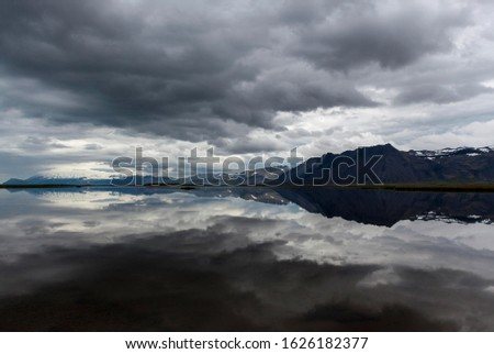 Lake, mountains at the back, dark clouds are reflected in the water, near Gardar, Snaefellsnes peninsula, Iceland #1626182377