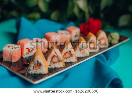 Sushi rools with blue background and decors #1626200590
