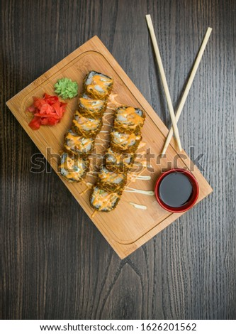 Sushi roll with sauce and sticks #1626201562