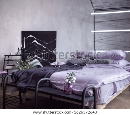Elegant lilac house bedroom interior with bed, big picture, table and lights