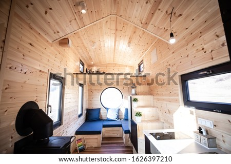 Mobile tiny house interior. Great for outdoor experiences and wildlife. Lots of space and pure adventure. Royalty-Free Stock Photo #1626397210