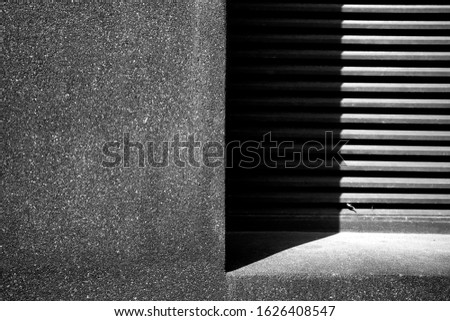 Abstracted light and shadow shade background of building grit wall texture and air ventilation grill with multiple exposure photography