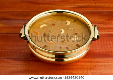 predaman payasam-sweet dish which is famous in south india made  in special occasions  arranged in an urule in indian style garnished with dry fruits