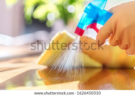 Cleaning with spray detergent, rubber gloves and dish cloth on work surface concept for hygiene #1626450310