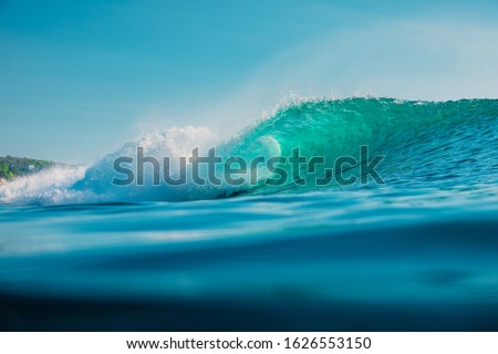 Barrel wave in ocean. Blue wave with sun light Royalty-Free Stock Photo #1626553150