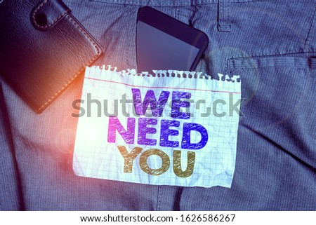 Word writing text We Need You. Business concept for Company wants to hire Vacancy Looking for talents Job employment Smartphone device inside trousers front pocket with wallet and note paper. #1626586267