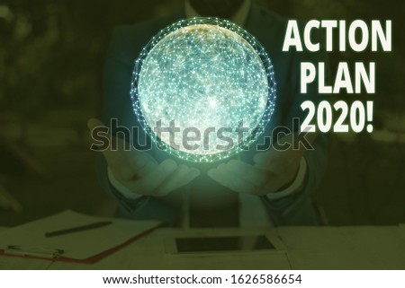 Handwriting text writing Action Plan 2020. Concept meaning proposed strategy or course of actions for current year Elements of this image furnished by NASA. #1626586654