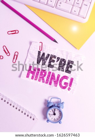 Text sign showing We Re Hiring. Conceptual photo recently employ someone or pay him to do particular job Flat lay above white blank paper with copy space for text messages. #1626597463