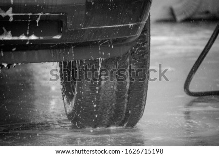 truck tires getting cleaned at the carwash #1626715198