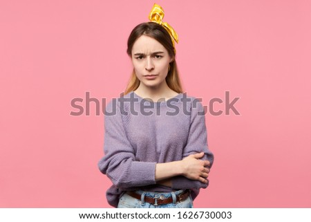 Human facial expressions, life perception and attitude. Horizontal shot of serious stylish young woman wearing yellow headscarf keeping arms on her chest, closed posture expressing distrust #1626730003