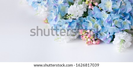 Flower frame, banner. Postcard with blue hydrangea flowers on a white background. Space for text