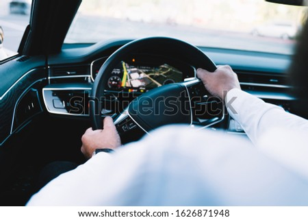 Executive vehicle transport for comfortable roadway, male driver steering automobile getting to travel destination in autonomous motorized car with cockpit dashboard for safety navigation #1626871948
