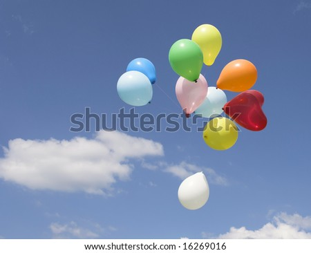 Bunch of party balloons against blue sky #16269016