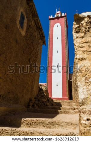 Red and white mosque tower seen in a Berber village deep in the Atlas Mountains, Morocco in August 2013. #1626912619