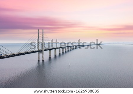The Oresund bridge between Copenhagen Denmark and Malmo Sweden when sunset in an evening of May Royalty-Free Stock Photo #1626938035