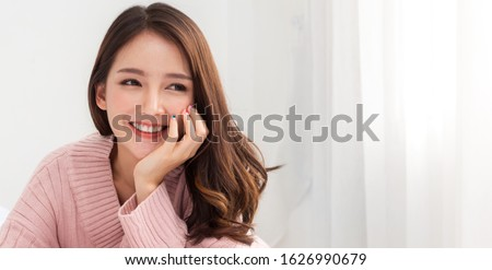 Smiling of cheerful beautiful pretty asian woman clean fresh healthy white skin posing in warm knitted pink clothes.Girl felling relaxing and enjoy time on the bed at home.asia beauty Royalty-Free Stock Photo #1626990679