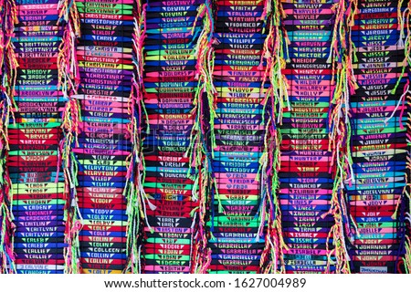 wrist bands of names in multiple colors whats in a name. Is my name here. Names on display Royalty-Free Stock Photo #1627004989