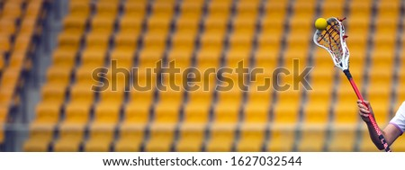 Lacrosse sticks on the background of stadium chairs