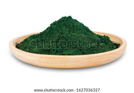 spirulina powder in wooden dish isolated on white background. seaweed powder in dish bowl isolated on white background. kelp powder in wooden dish isolated on white background with clipping path #1627036327