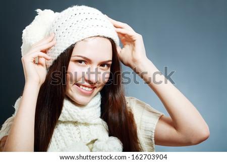 Cheerful woman clothing in warm hat. Winter season. #162703904
