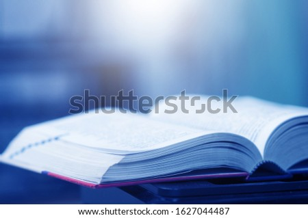 Book stack in the library and blurred bookshelf background for education. education background. back to school concept. #1627044487