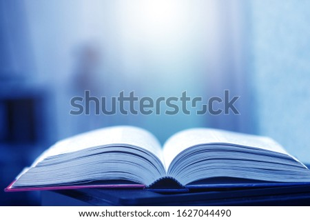 Book stack in the library and blurred bookshelf background for education. education background. back to school concept. #1627044490