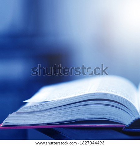 Book stack in the library and blurred bookshelf background for education. education background. back to school concept. #1627044493
