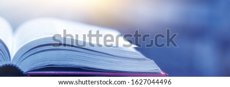 Book stack in the library and blurred bookshelf background for education. education background. back to school concept. #1627044496