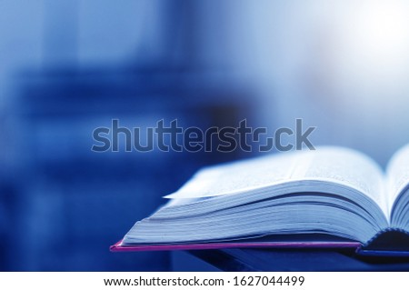 Book stack in the library and blurred bookshelf background for education. education background. back to school concept. #1627044499