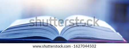 Book stack in the library and blurred bookshelf background for education. education background. back to school concept. #1627044502