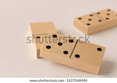 Playing dominoes on a white background. Leisure games concept. Domino effect #1627068484