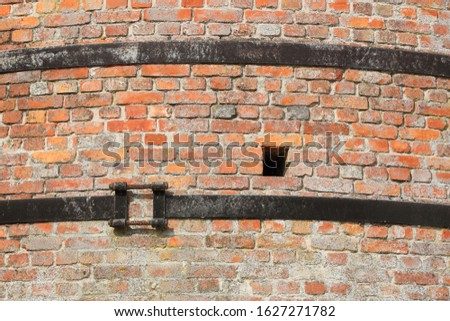 A closeup of an old stone furnace which is out of order #1627271782