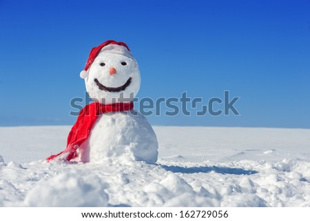 snowman on blue sky background Royalty-Free Stock Photo #162729056