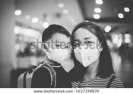 Coronavirus covid-19 concept.Little chinese boy with mother wearing N95 mask for protect from coronavirus for back to school.School kid go to school with mom.New normal lifestyle post coronavirus. #1627298839