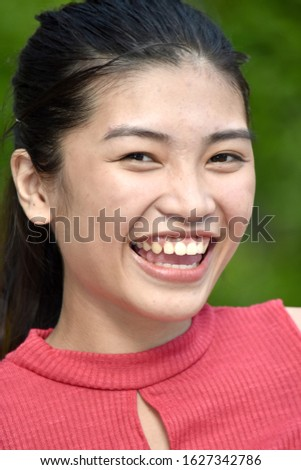 An Asian Youngster And Laughter #1627342786