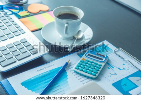 Excel graph with Spreadsheet Document showing Information Financial Startup Concept. Financial Planning making Accounting Database Report. Graphs and chart on screen with stationery set business stuff #1627346320