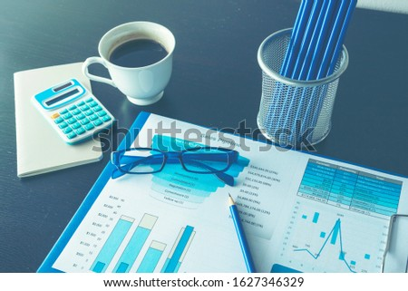 Excel graph with Spreadsheet Document showing Information Financial Startup Concept. Financial Planning making Accounting Database Report. Graphs and chart on screen with stationery set business stuff #1627346329