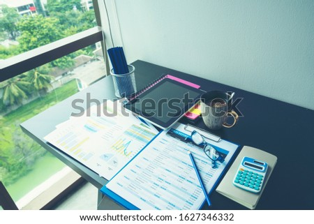 Excel graph with Spreadsheet Document showing Information Financial Startup Concept. Financial Planning making Accounting Database Report. Graphs and chart on screen with stationery set business stuff #1627346332