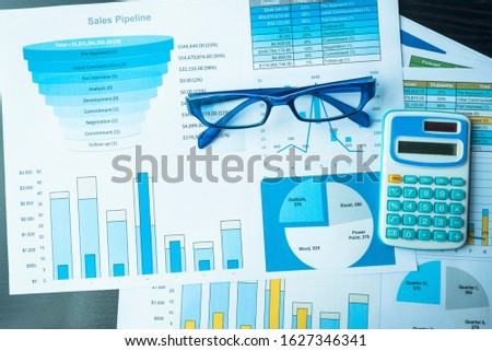 Excel graph with Spreadsheet Document showing Information Financial Startup Concept. Financial Planning making Accounting Database Report. Graphs and chart on screen with stationery set business stuff #1627346341