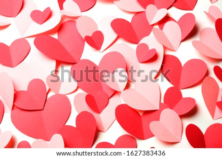 Bunch of cut out of pink and red paper hearts on white background closeup. Good Valentines day, Womans day, love, romantic or wedding card, banner, invitation background for banner, congratulation #1627383436