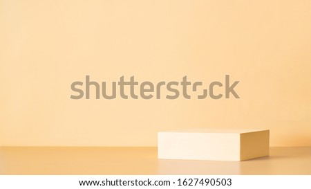 Abstract background for branding, identity and packaging presentation. Light yellow podium on cream yellow paper background. Copy space for text, design or mock up product. Banner #1627490503